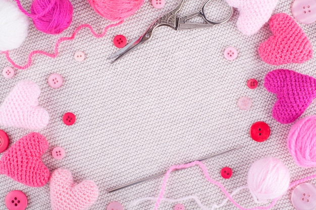 Knitted pink hearts frame