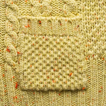 Knitted pocket on a knitted sweater background