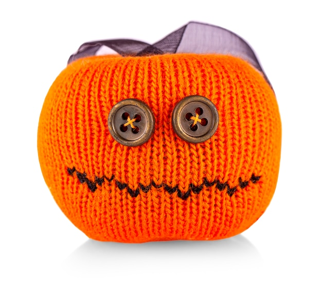 Knitted pumpkin toy for halloween on white background