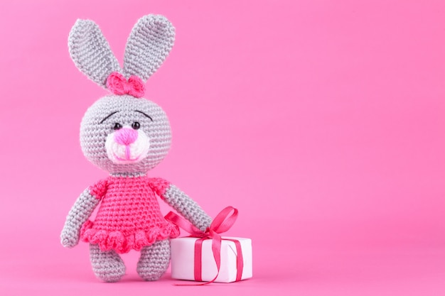 Knitted rabbit in pink dress. st. valentine's day decor. knitted toy, amigurumi. valentines day greeting card.