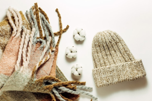 Knitted scarf and hat. warm winter clothes. top view, flat lay.