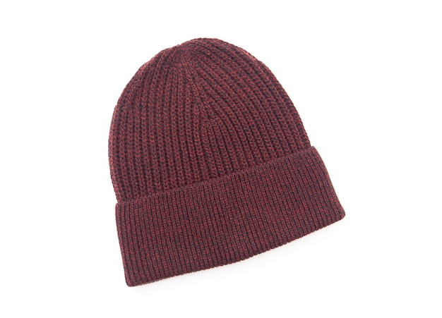 Knitted seasonal autumn winter hat isolated on white