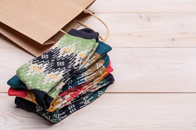 Knitted socks, craft paper gift bag.