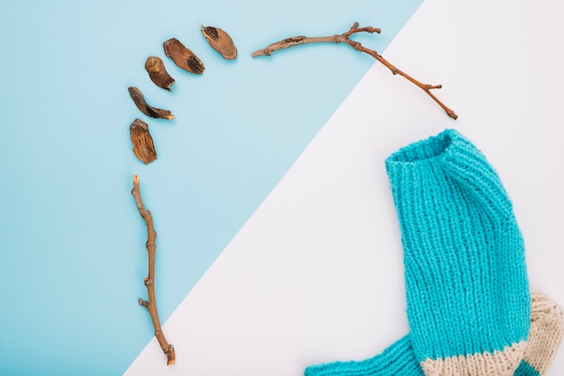 Knitted socks and twigs
