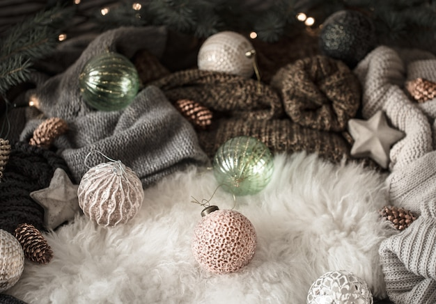 Knitted sweater and christmas decoration , top view. still life