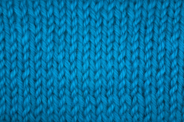 Knitted texture, front surface. natural wool, classic blue, monochrome. close-up, background