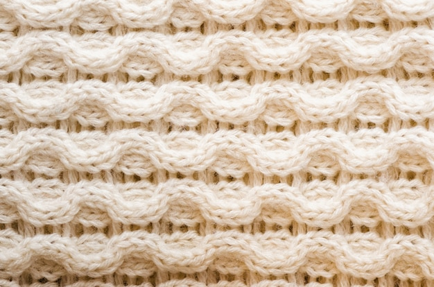 Knitted texture. pattern fabric made of wool. background, copy space