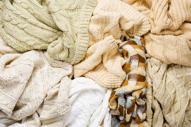 Knitted winter sweaters background