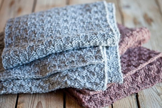 Knitted woolen grey and brown scarves