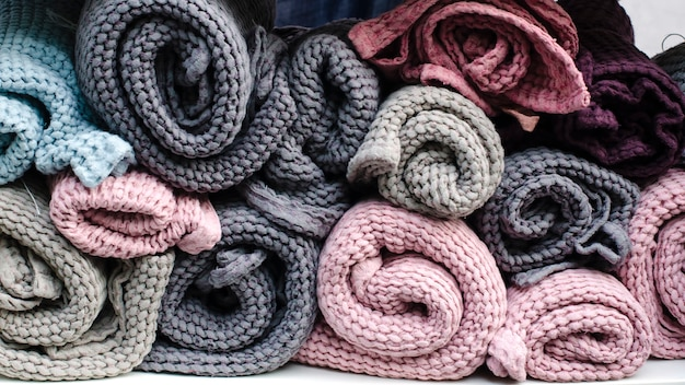 Knitted woolen rugs in pastel colors