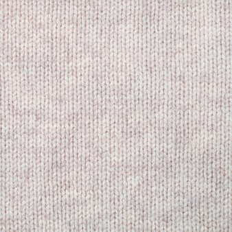 Knitted woollen texture background. plain knitting