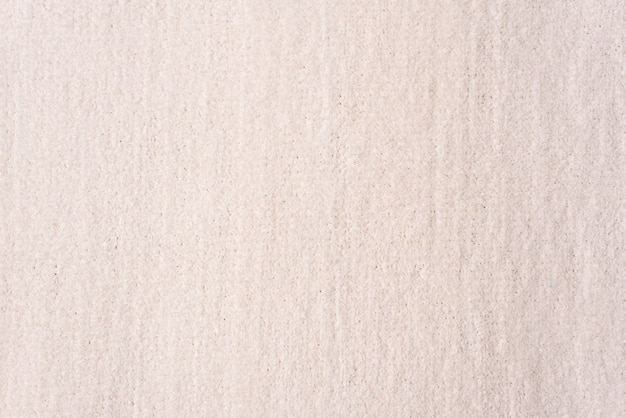 Knitting background texture light beige color. fabric textile background