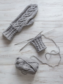 Knitting gloves made of gray wool. top view.