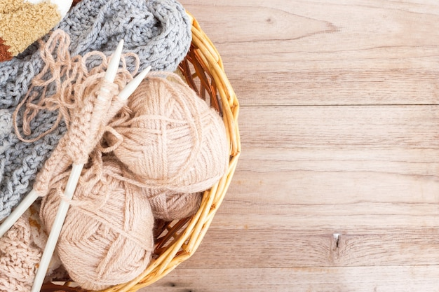 Knitting materail in a basket, handcraft tools.