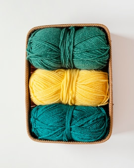 Knitting needles and wool in basket