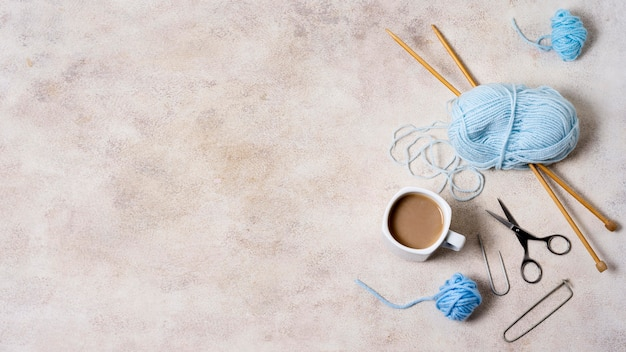 Knitting tools on table with copy-space
