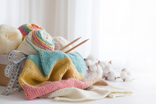 Knitting wool and knitting needles in pastel colors