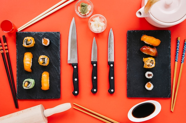 Knives among sushi and condiments