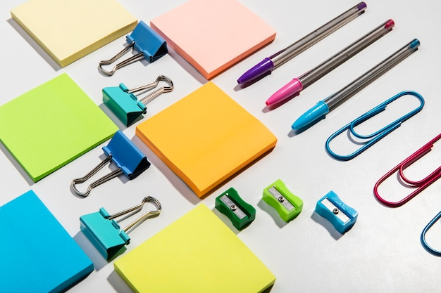 Knolling concept with sticky notes and accessories high view