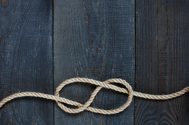 Knot of rope on the wooden background