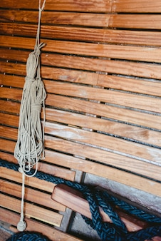 Knotted boat ropes to hold sails.