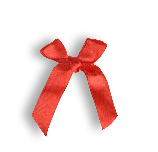 Knotted bow made of red silk ribbon isolated on white, close up