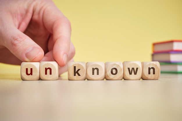 Know and unknow concept on wooden cubes.