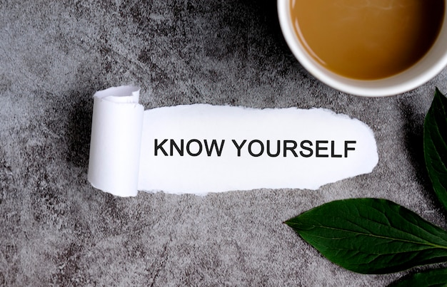 Know yourself with cup of coffee and green leaf