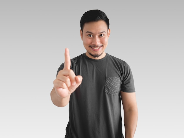 Knowing face of asian man who got an idea and show one finger of solving.