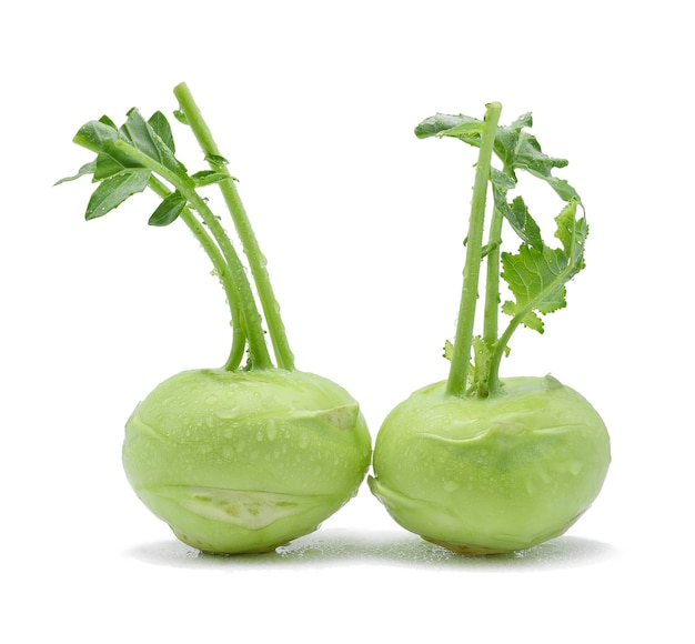 Kohlrabi and water drops on white background.