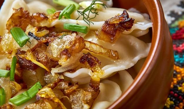 Koldunai, meat dumplings, lithuanian  cuisine, baltic traditional assorted dishes, top view.