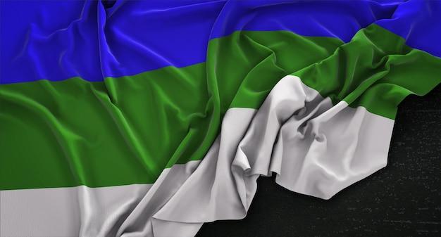 Bandiera della republica di komi ruggine su sfondo scuro 3d rendering