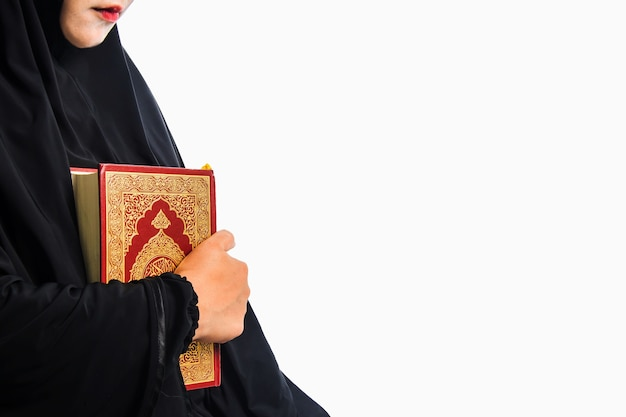 Koran in hand - holy book of muslims (public item of all muslims) koran in hand