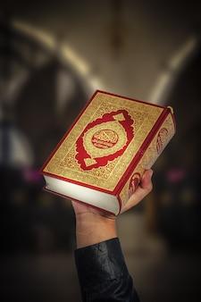 Koran in hand - holy book of muslims