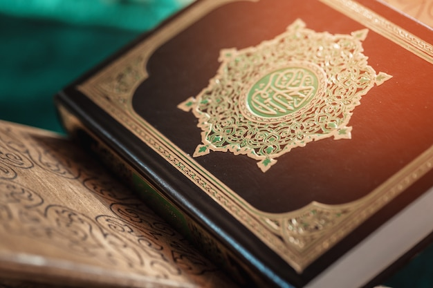 Koran holy book and coffee cup