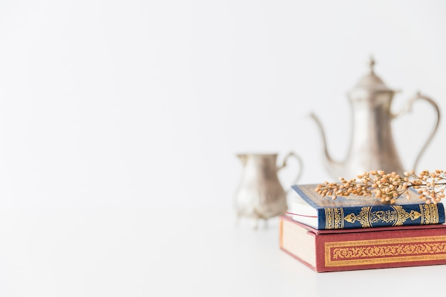 Koran with branch and tea utensil