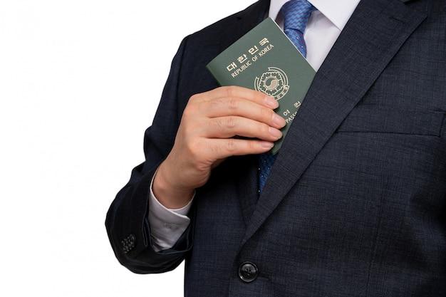 Korean businessman holding a korean passport in hand.