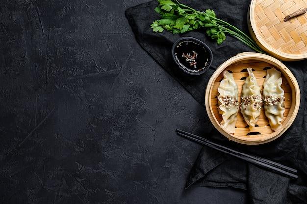 Korean dumplings in a traditional bamboo steamer.