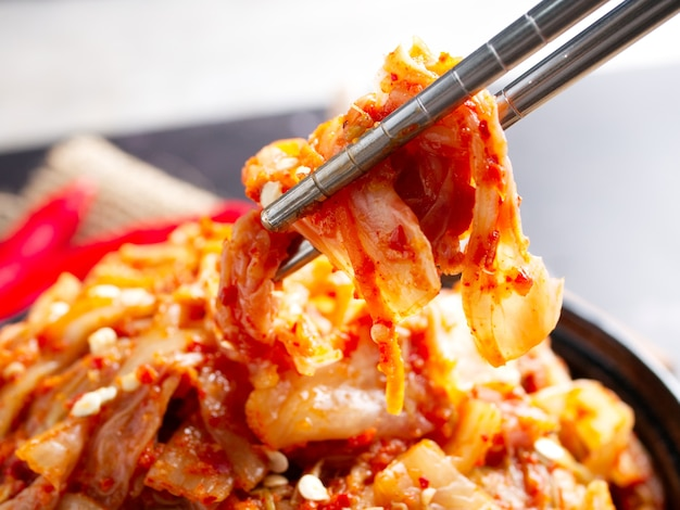 Korean food, cabbage kimchi in black dish.