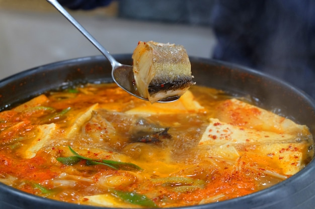 Korean food dongtae tang, spicy pollack stew in a hot pot.