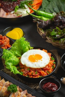Korean food. fried rice with kimchi serve with fried egg