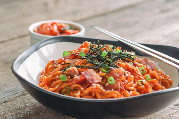 Korean hot and spicy fried instant noodle topped with bacon