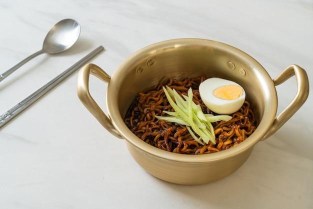 Korean instant noodle with black bean sauce topped cucumber and boiled egg (jajangmyeon or jjajangmyeon) - korean food style
