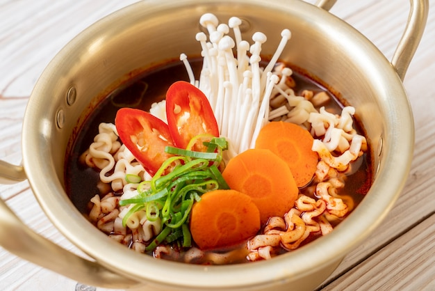 Korean instant noodles in golden pot