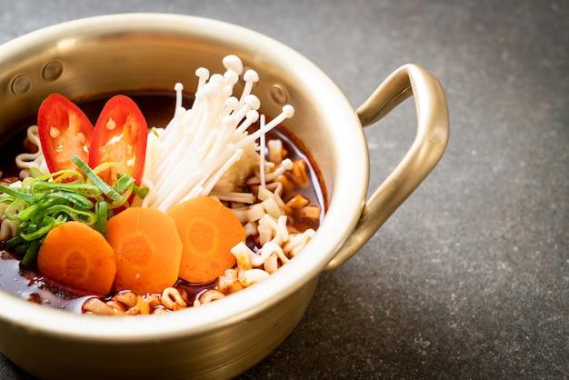 Korean instant noodles in golden pot