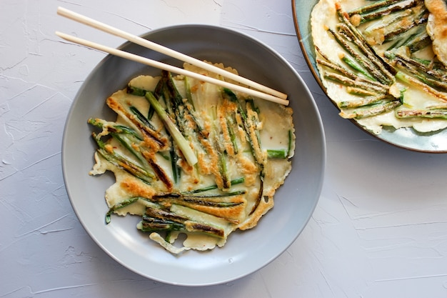Korean pancakes with green onion and soy sauce