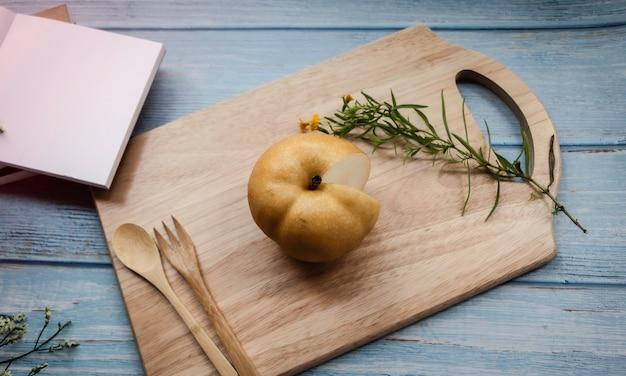 Korean pear on wooden board