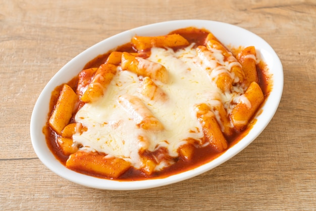 Korean rice cake in spicy korean sauce with cheese, cheese tokpokki, tteokbokki with cheese. korean food style