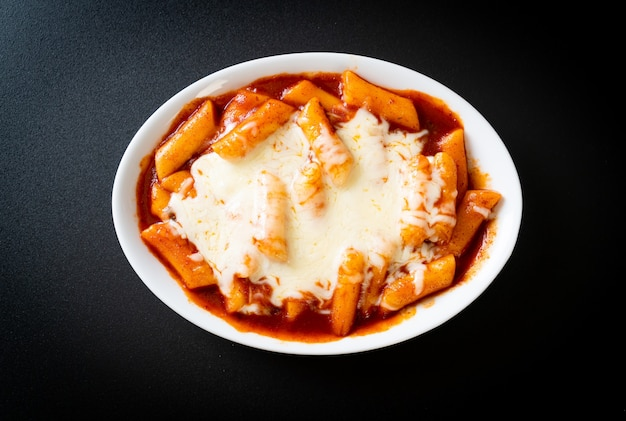 Korean rice cake in spicy korean sauce with cheese, cheese tokpokki, tteokbokki with cheese - korean food style