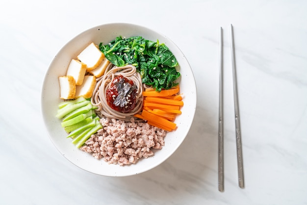 Korean spicy cold noodles - bibim makguksu or bibim guksu - korean food style